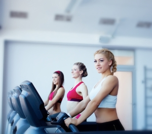 Three beautiful girls in fitness center