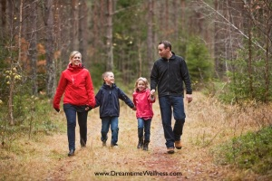Family walking in the woods