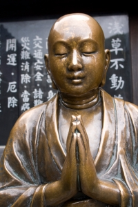 Beautiful copper Buddha statue at a shrine near Senso-ji Temple, Asakusa, Tokyo, Japan