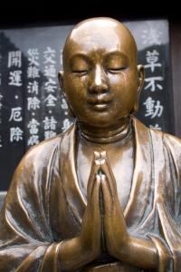 Beautiful copper Buddha statue at a shrine near Senso-ji Temple, Asakusa, Tokyo, Japan